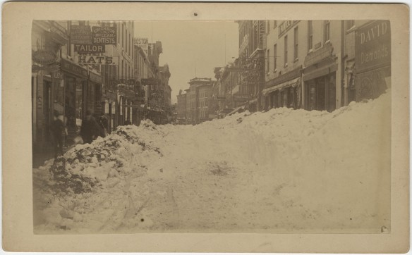 "Looking west on Asylum Street from Main Street. ""Drifts from the great snow-storm of March 12th, 1888. Hartford. The Connecticut Historical Society collections."