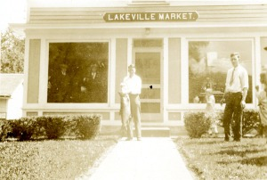 Dr. Hall with the monster lake trout in front of Goderis' Market, Lakeville, CT.
