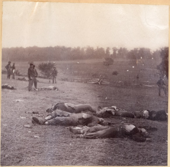 Bodies of Union troops are gathered at the end of the first day's fighting at Gettysburg, July 1, 1863. Temperatures in the 90s accelerated decomposition. CHS 1968.58.149.29