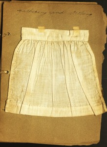 Sample of gathering cloth with stitches by Mildred Ledyard. ms 101782