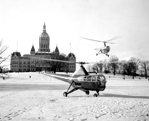 With the state capitol building as a backdrop, G. Fox & Co.'s helo fleet creates a landing zone in the park.