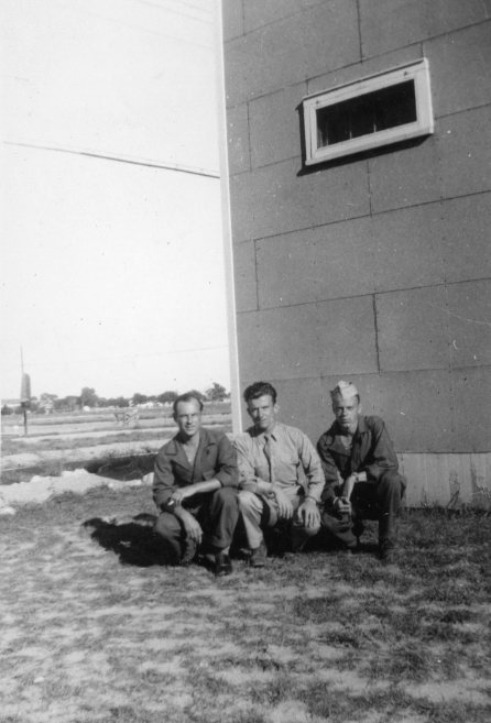 "Quish flanked by a couple of his buddies (identified as ""Dingie"" and ""Smuck"") at their base in Italy, 1944."