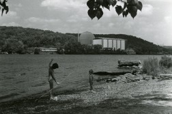 Fact-based and sensible caption: View of Connecticut Yankee Atomic Power Company, Haddam Neck, 1968. Two children play by the Connecticut River in Haddam Meadows State Park. Appropriate caption written by any sensible parent: Oh, hell no. Drop the fish, we're outta here. *Note: This image DID make it into the WNPR article, because how could it not?