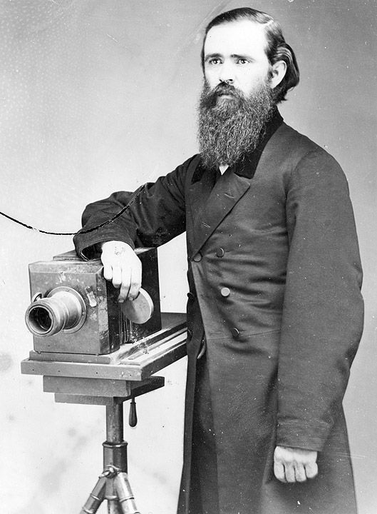 John Gilbert Doughty posing with one of his studio cameras, ca. 1890s. CHS 2014.32 collection