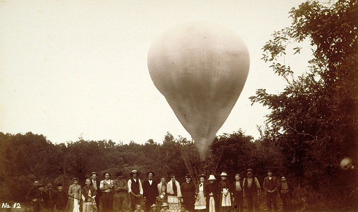 The balloon is partially inflated in this view, probably in Winsted. As the balloon rises, the gas inside will expand the envelope into a more spherical shape. CHS X.2000.20.18
