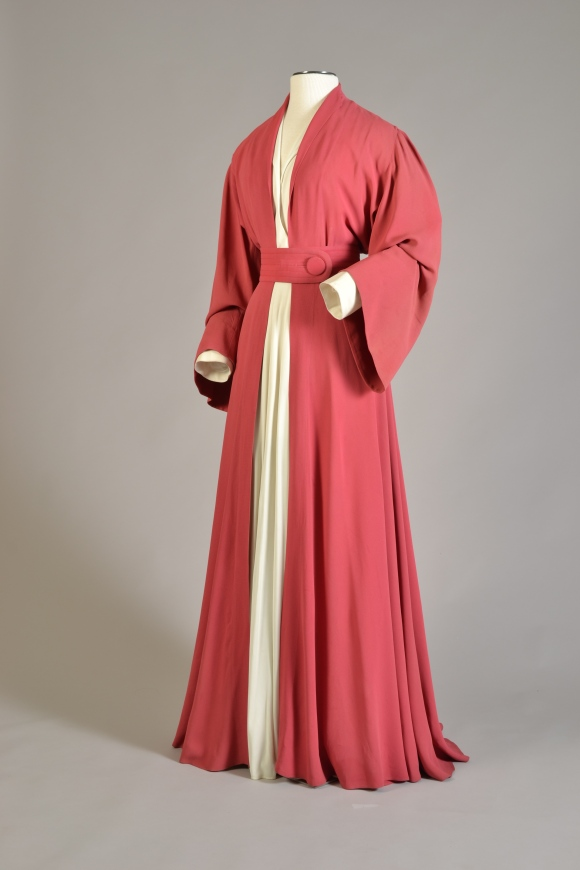 Costume for stage production of The Philadelphia Story (1939), ensemble of red silk and white Celanese, KSUM Collection, Gift of the Estate of Katharine Hepburn Playbill columnist Louis Botto was in the audience one evening and remembered the audible gasp from the audience when Katharine Hepburn entered wearing this costume.