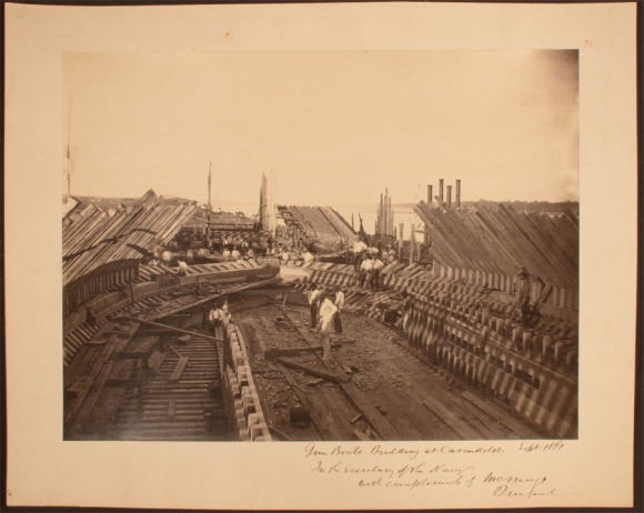 "Heavy wooden framing was required to support the weight of machinery, armament and iron plating. This view shows several ""City"" class river ironclads building at James Eads's Union Marine Works in Carondelet, Missouri, September 1861. Within five months they would be in action on the Tennessee and Cumberland rivers. CHS 2013.225.19"