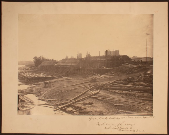 "The sloped casemate superstructure of the ""City"" class ironclads is evident in this view taken at the Union Marine Works in Carondelet, Missouri, September 1861. These shallow-draft vessels would be side-launched into the Mississippi. CHS 2013.225.18"