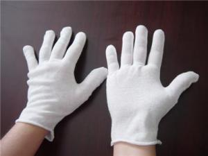 White gloves often seen in museum and archives settings.