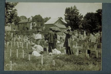 Children decorate veterans' graves, Spring Grove Cemetery, Hartford, 1909. CHS X.2000.8.45 (CD 0542 img0022)
