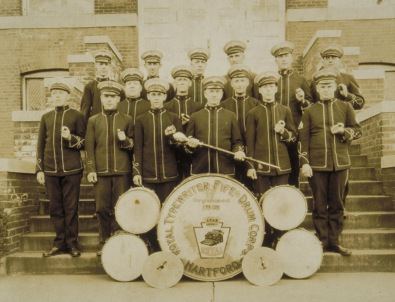 """Royal Typewriter Fife and Drum Corps, Hartford, ca. 1920. Connecticut Historical Society collection. Note the sign on the large drum in the foreground, which reads: """"Royal Typewriter Fife and Drum Corps/Hartford/Organized 1918""""."""