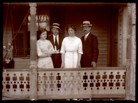 Two couples pose on the front porch of a Hartford house, ca. 1920. CHS 1995.36.1591