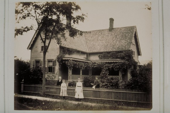 A Windsor family poses in front of their home featuring a splendid front porch. CHS 2000.191.265