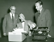 """Royal Typewriter Publicity Photograph, 1957. Gift of Edward Belsho, Connecticut Historical Society collection. Typed on the back of the photograph: """"Movie star Ray Bolger demonstrates his typing skills for President Fortune P. Ryan in 1957 as H. C. Davis, Vice President for Sales, observes."""""""