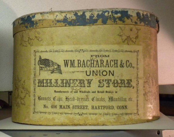 A late example dating to 1869, this bandbox bears the patriotic label of Hartford milliner William Bacharach. CHS 1959.79.2