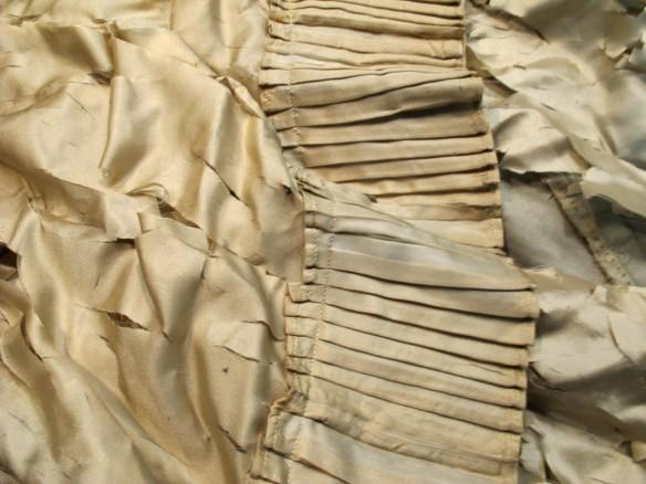 Internal hem ruffle on weighted silk lining.